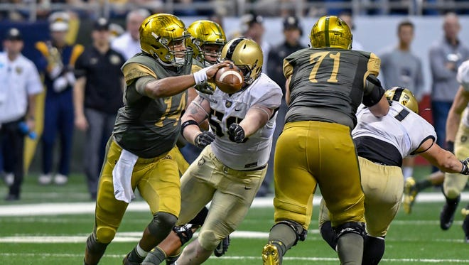 Notre Dame Fighting Irish quarterback DeShone Kizer (14) is pressured by Army Black Knights nose guard Andrew McLean (58) in the second quarter at the Alamodome.