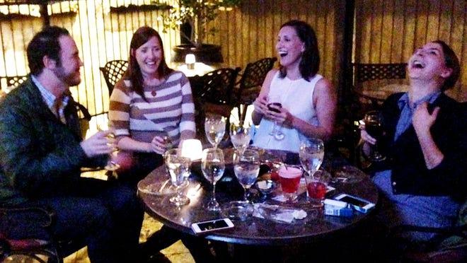 Hunter Lewis, Christin Miller Self, Amanda Chervenak, Katie Caldwell enjoy a drink on the patio of Vintage Wine Bar & Spirits.