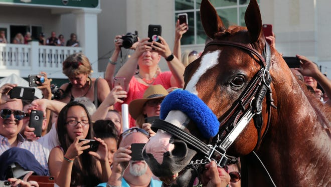 Fans turn out at Churchill Downs Saturday night to honor Triple Crown winning Justify. 