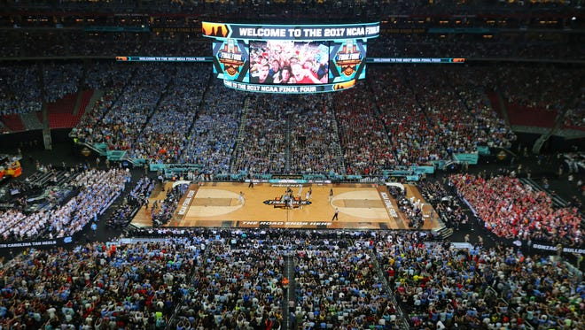 The opening tipoff of the NCAA national championship game between North Carolina and Gonzaga is seen from above at University of Phoenix Stadium in Glendale on Monday, April 3, 2017.