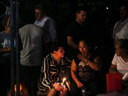 July 28, 2017 - Loved ones comfort Claudia Linares at her Surrey Lane home during a candlelight vigil honoring her late husband, Ismael Lopez, in Southaven on Friday night. Lopez, 41, was an auto mechanic who was fatally shot by Southaven police on Sunday night. The officers were on the street to serve a search warrant to a domestic violence suspect but went to the wrong house.