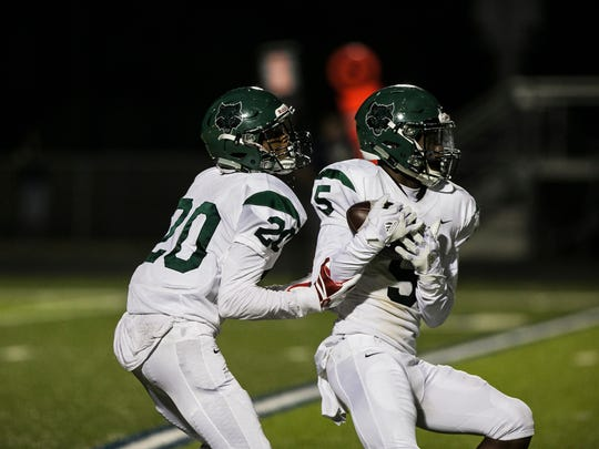 October 20, 2017 - Cordova's Brylan Sullivan (20) runs behind Cailen Jones (5) during a punt return in the fourth quarter against the Arlington Tigers at Arlington High School on Friday.