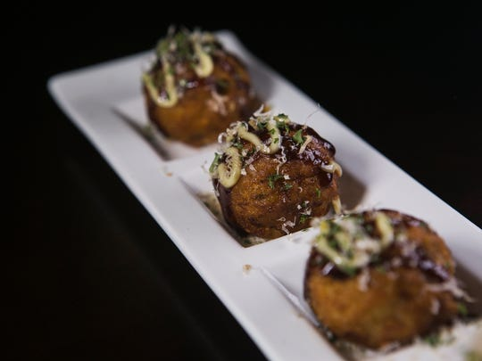 October 22, 2017 - Takoyaki includes deep fried wheat balls with octopus and topped with Japanese mayo, okonomi sauce and bonito flakes at Sakura Japanese Restaurant located at 4840 Poplar Ave.