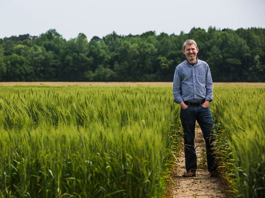 Pete Nelson, president of AgLaunch, stands in a field