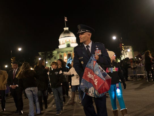 General Steven L. Kwast passes out candy during the