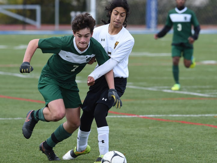 Spackenkill's Viktor Drasny, left, battles with Fallsburg's