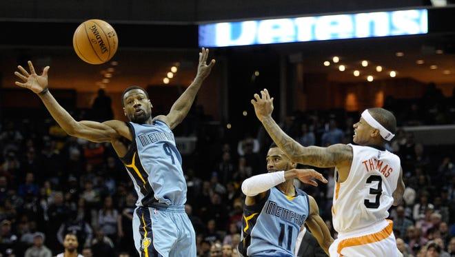 Phoenix Suns guard Isaiah Thomas (3) loses the ball against Memphis Grizzlies forward Tony Allen (9) and Memphis Grizzlies guard Mike Conley (11) during the game at FedExForum in Memphis on Jan. 11. Memphis Grizzlies beat Phoenix Suns 122 - 110.