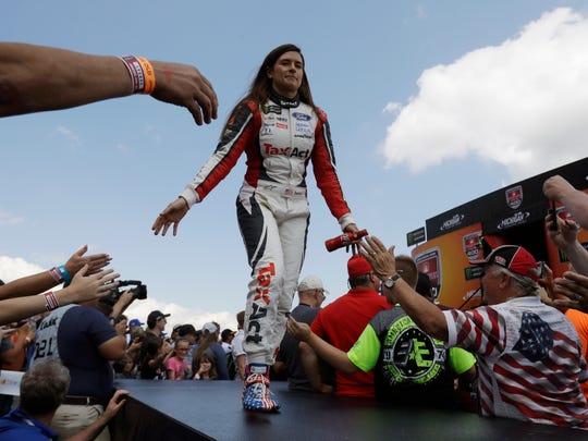 Danica Patrick greets fans before a NASCAR Sprint Cup series auto race, Sunday, June 18, 2017, in Brooklyn, Mich.