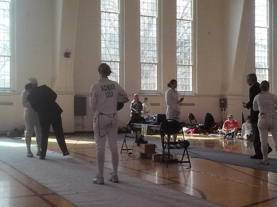 Sofia Komar, who has participated in multiple major fencing championships across the world in the last several months, spends around 20 hours a week at fencing practice. Here, she prepares for a bout.