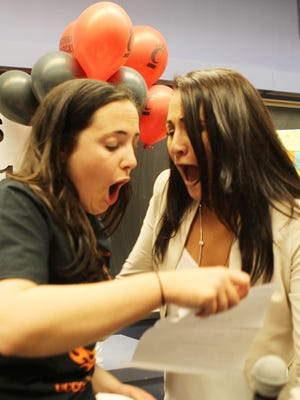 """University of Cincinnati medical student Katie Peticca (left) reacts as she opens her """"match day"""" letter, which tells students where they will go for their residency.  At right is her sister, Madison Pettica.  Katie Peticca will do her residency in ob-gyn at the University of Pittsburgh Medical Center."""