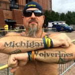 A few minutes with ... a man with 31 U-M tattoos and counting