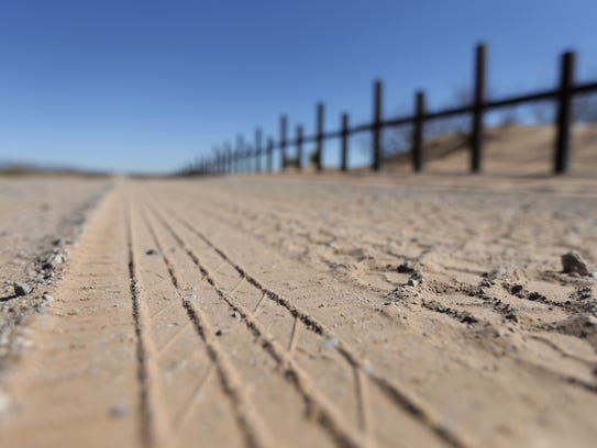 Tire tracks from Border Patrol vehicles parallel the