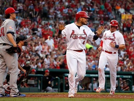 St. Louis Cardinals' Yadier Molina (4) celebrates after
