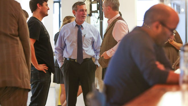Gov. John Carney tours The Mill coworking space in Wilmington, home to numerous startups and small businesses.