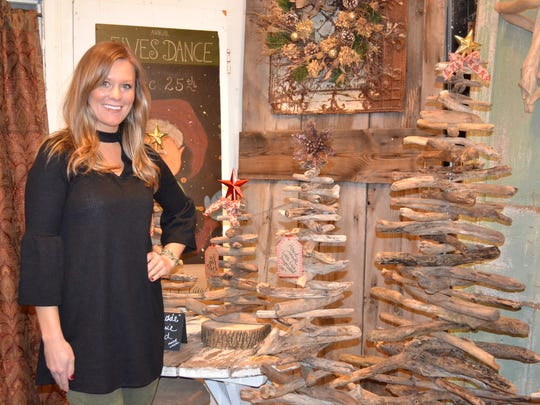 Lauren Shaw with her handmade Lake Erie driftwood trees in her mother's shop, Blue Door.