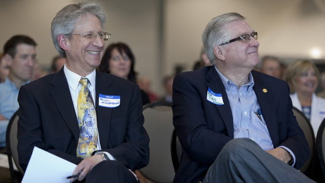 St. Clair County Administrator Bill Kauffman, left, smiles as he listens along with Rep. Paul Muxlow during a ribbon cutting ceremony in April 2015 at the Blue Water Convention Center in Port Huron.