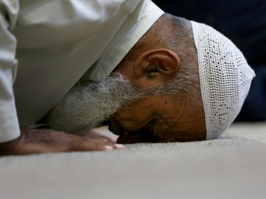 Zafar Ali, who is a family member of a mosque member visiting from Pakistan, performs sujud during Friday prayers at Masjid Al-Noor, central Wisconsin's only mosque, May 27, 2016.