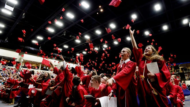 File photo of graduates celebrate at the end of the Ravenwood High School commencement ceremony at Belmont University Saturday, May 27, 2017, in Nashville Tenn. Graduates celebrate at the end of the Ravenwood High School commencement ceremony at Belmont University Saturday, May 27, 2017, in Nashville Tenn.