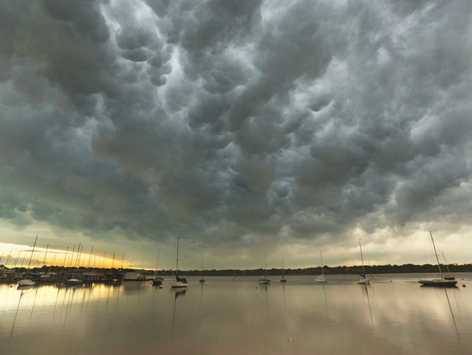 A stunning display of mammatus clouds roll in at White