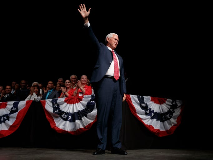 Pence waves as he arrives in Miami on June 16, 2017,