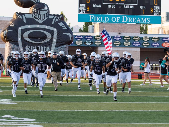 The Onate Knight football team takes the field during