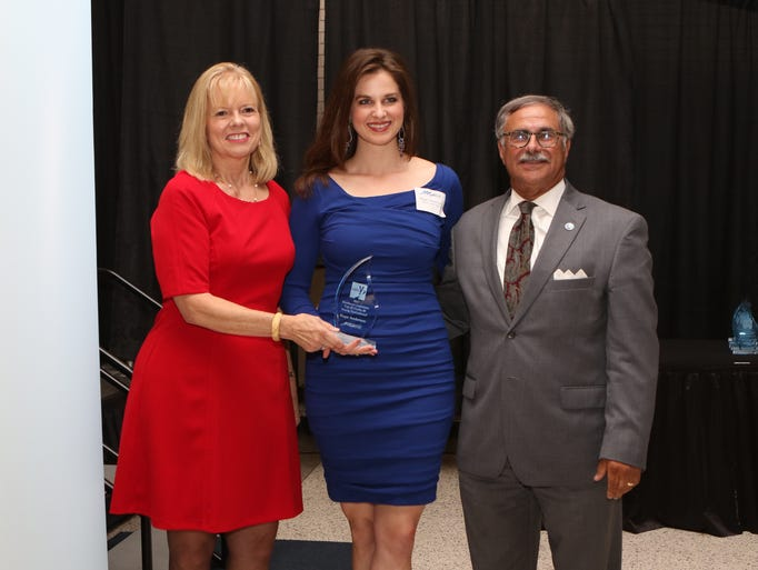 Hope Anderson of Health with Hope, center, receives
