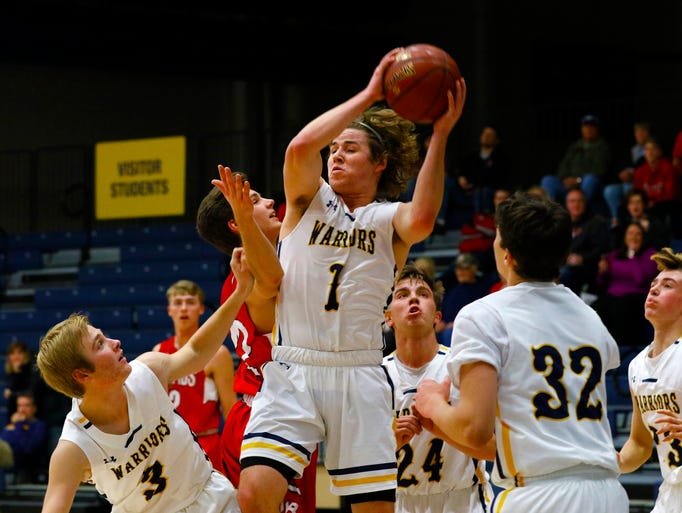 West's Mitchell Michalske(1), middle, rebounds the