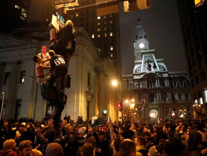 Philadelphia Eagles fans celebrate the team's victory