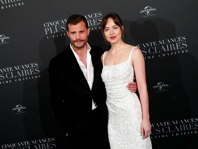 Jamie Dornan, left, and Dakota Johnson pose during