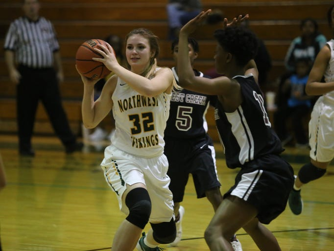 Northwest's Madison King (32) looks to pass the ball