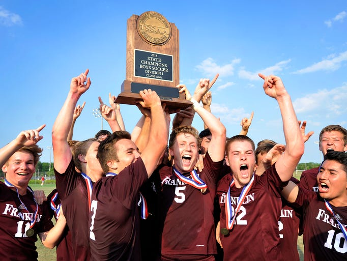 Franklin players celebrate a 1-0 win over Collierville with a trophy in the Class AAA Soccer Championship game in Murfreesboro, Tenn., Friday, May 23, 2014.
