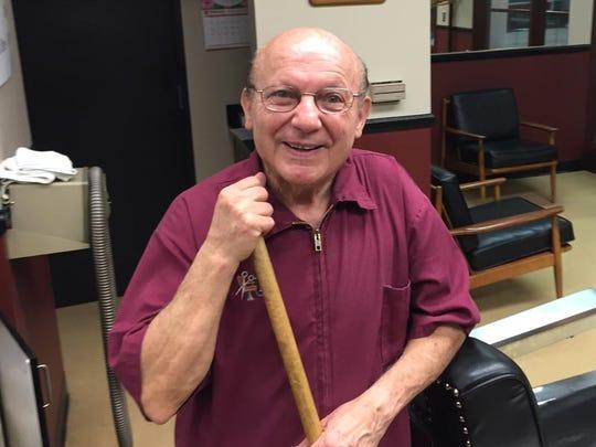 Sam Zeolla has been cutting hair since 1954 inside downtown Detroit.