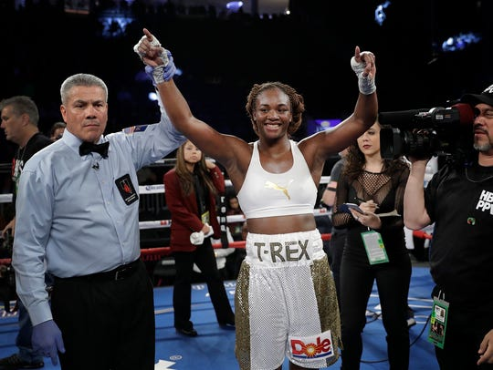 Claressa Shields celebrates after defeating Franchon