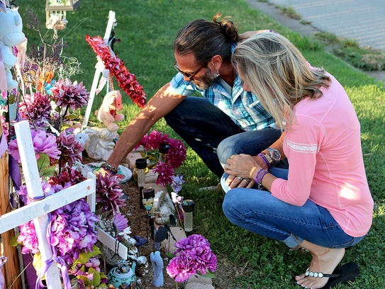 Vern and Bianka Landavazo look over mementos left behind at the memorial for their daughter, Lauren Landavazo, on Aug. 28, 2017. Lauren was murdered on Sept. 2, 2016.