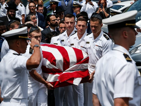 Midshipmen from the U.S. Naval Academy carry Midshipman