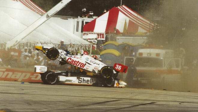 Tony Kanaan (36, on top) and Bryan Herta (8) are tangled after coming into turn five at Elkhart Lake's Road America.