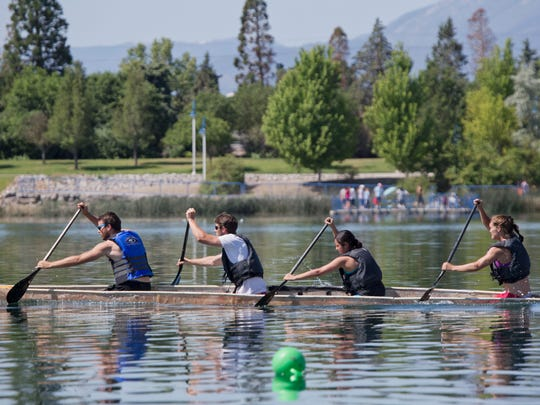 UNR engineering student coed team members, from left, Austin Martin, Wes Munson, Anabel Hernandez and Alia Parker practice for the concrete canoe national race. University of Nevada engineering students coed team, left to right:  Austin Martin, Wes Munson, Anabel Hernandez and Alia Parker practice for the concrete canoe national championship race at the Sparks Marina on Saturday, June 7, 2014.