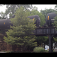 Crude-oil tank cars pass over the North Main Street bridge in the village of Pittsford.