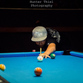 Kaiden Hunkins, 14, sporting a cast from an arm injury, has let little stop him from competing in top-level pool tournaments.