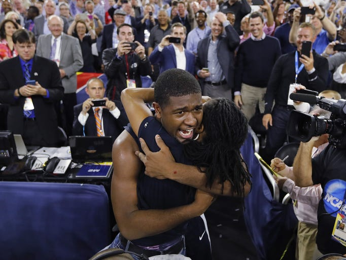Villanova forward Kris Jenkins is embraced after the