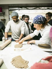 Vermont baker Heike Meyer shows students how to roll and cut out dough during a German holiday baking class at the McClure Multigenerational Center on Sunday, December 18 in Burlington.