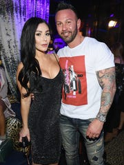 """In April, """"Jersey Shore"""" cast member Jenni """"JWoww"""" Farley and her husband, Roger Mathews, were all smiles at a a premiere party for the show. By September, the reality star had filed for divorce  from her husband of less than three years."""