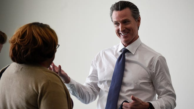 Gubernatorial candidate Gavin Newsom talks with a supporter before speaking with delegates Saturday at the California Democratic Party state convention in San Diego.