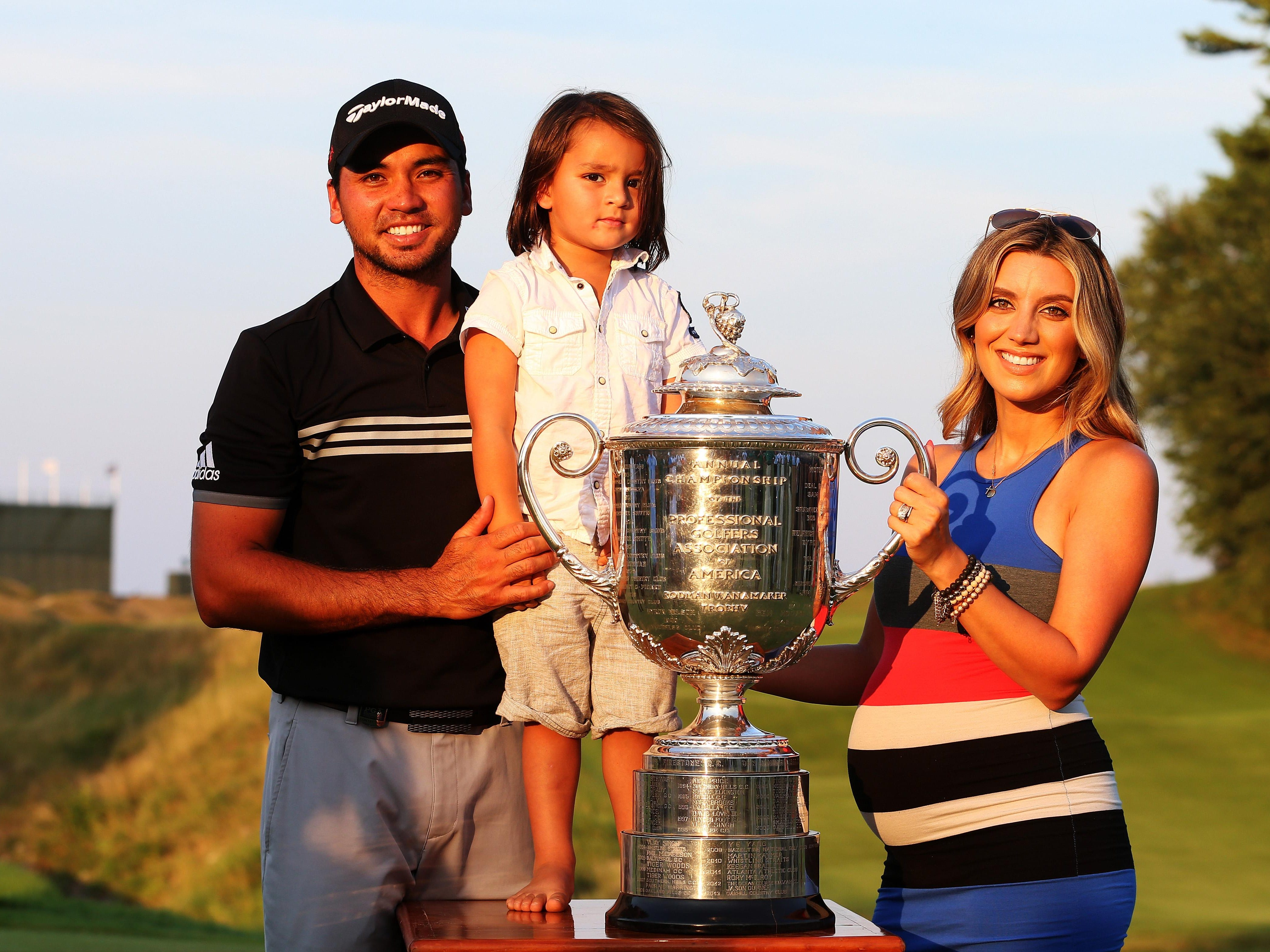 Jason Day of Australia poses with the Wanamaker trophy and his wife Ellie, a Lucas native, and son Dash after winning the 2015 PGA Championship with a score of 20-under par at Whistling Straits on August 16, 2015 in Sheboygan, Wisconsin.
