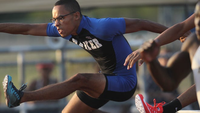 Ida Baker's Luis Colon finishes third in the 300 meter hurdles with a 40.41 time at the 3A Region 3 meet Thursday.