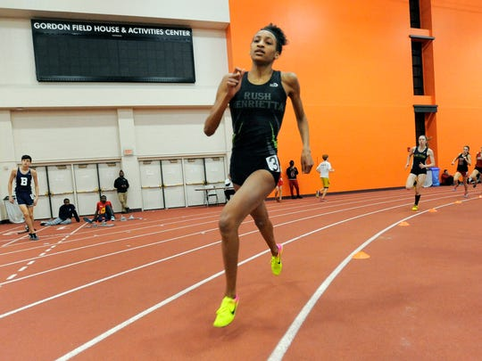 Rush-Henrietta's Sammy Watson stretches her lead on the field as she wins the Class A 600 meter run with a time of 1:35.69 during the Section V Class A/B Winter Track & Field Championships at RIT on Feb. 16, 2017.