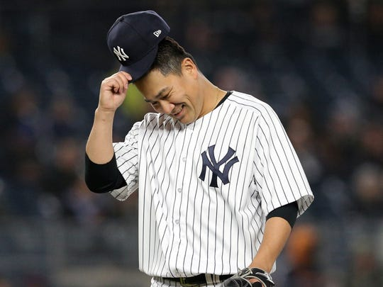 New York Yankees starting pitcher Masahiro Tanaka (19) reacts after being removed from the game against the Minnesota Twins.