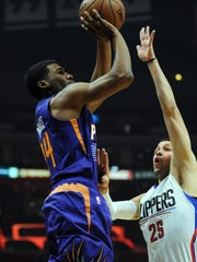 November 2, 2015; Los Angeles; Phoenix Suns guard Ronnie Price (14) shoots against the defense of Los Angeles Clippers guard Austin Rivers (25) during the first half at Staples Center.