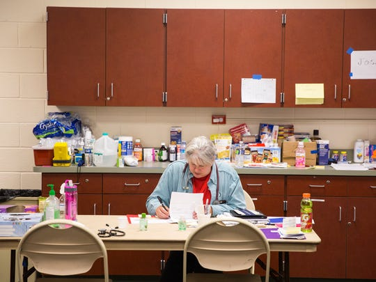 Suzanne R. Sudmeier, lead nurse for health services at the American Red Cross shelter in the Estero Recreational Center, works in the shelter's makeshift nursing office on Wednesday, September 20, 2017.