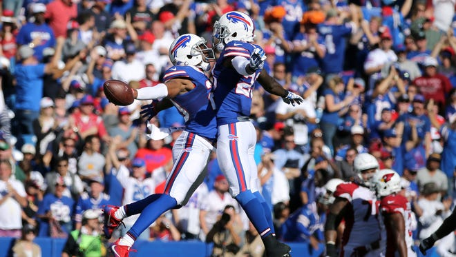 Bills safety Corey Graham (L) celebrates his interception with Aaron Williams in a 33-18 win over Arizona.
